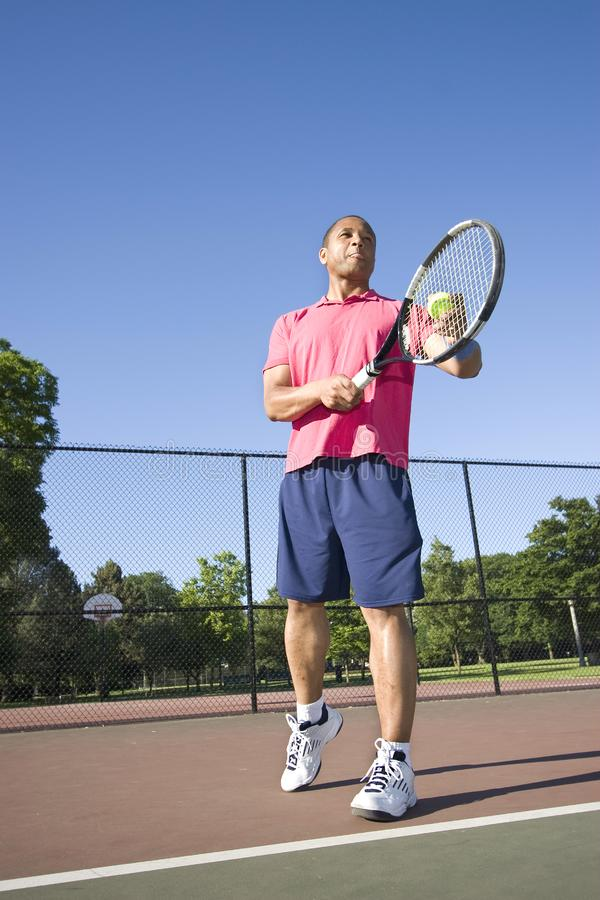 Man on Court Playing Tennis royalty free stock images