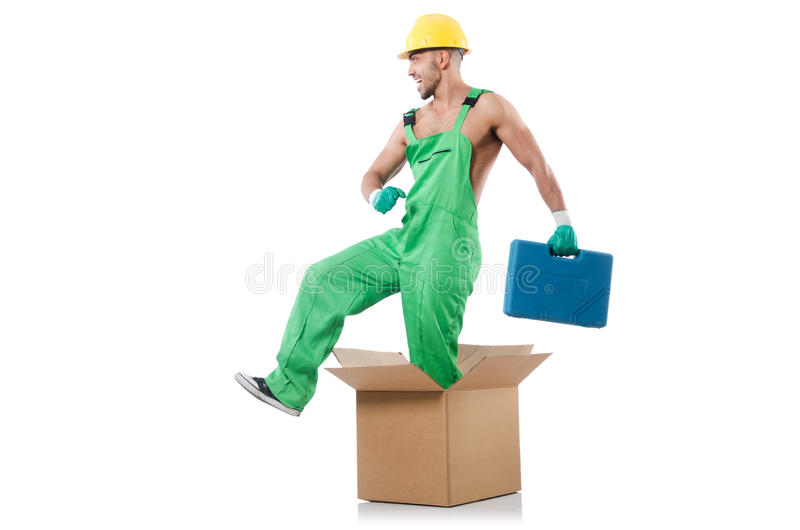 Man in coveralls. With boxes royalty free stock photo