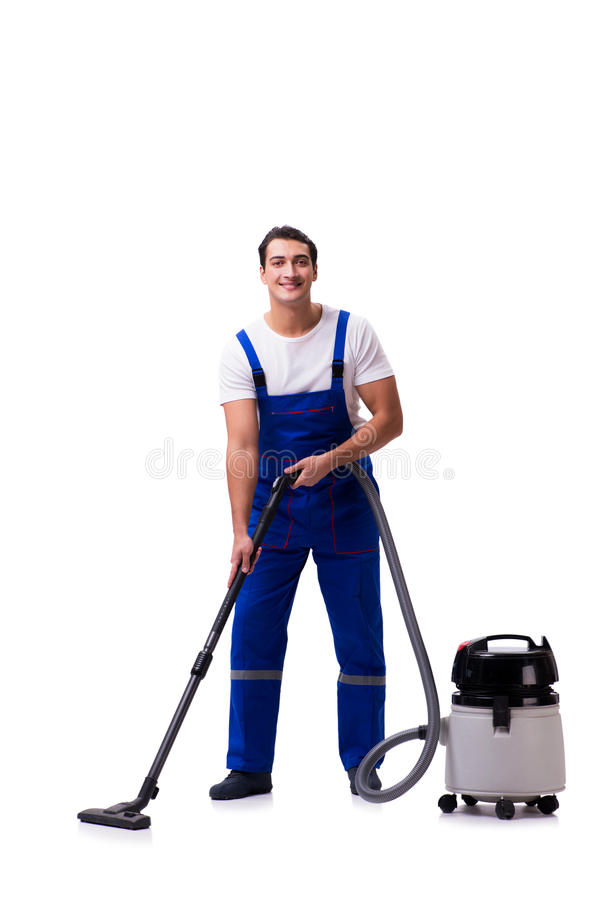 The man in coveralls doing vacuum cleaning on white. Man in coveralls doing vacuum cleaning on white royalty free stock images