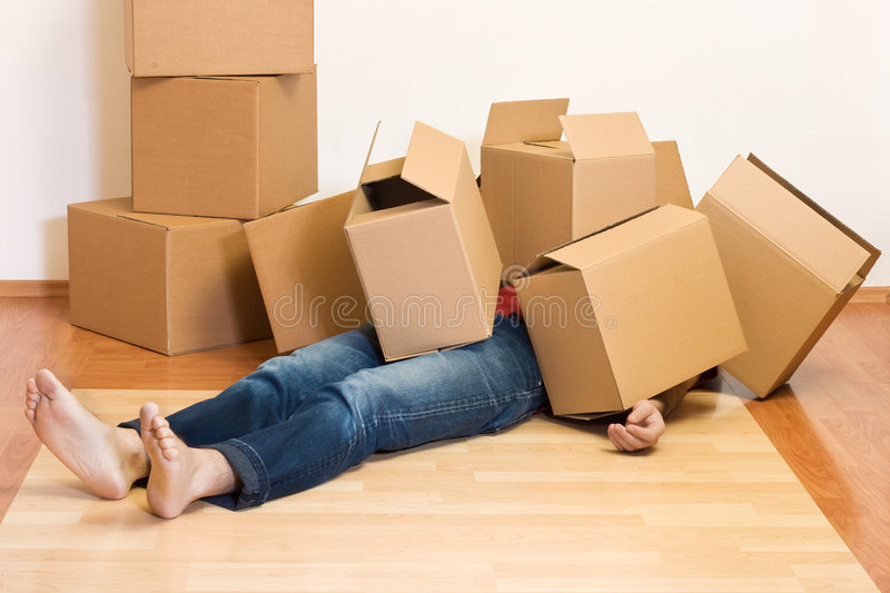 Man covered in cardboard boxes - moving concept stock images