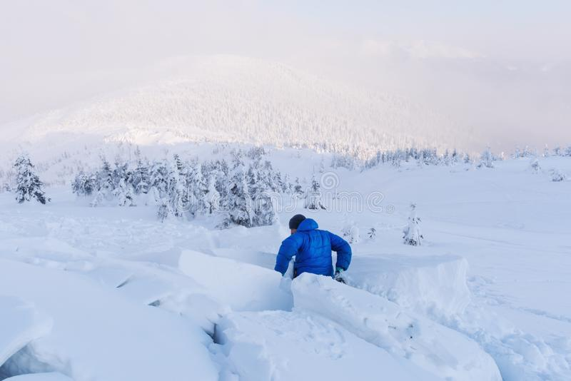 A man covered with a snow avalanche stock image