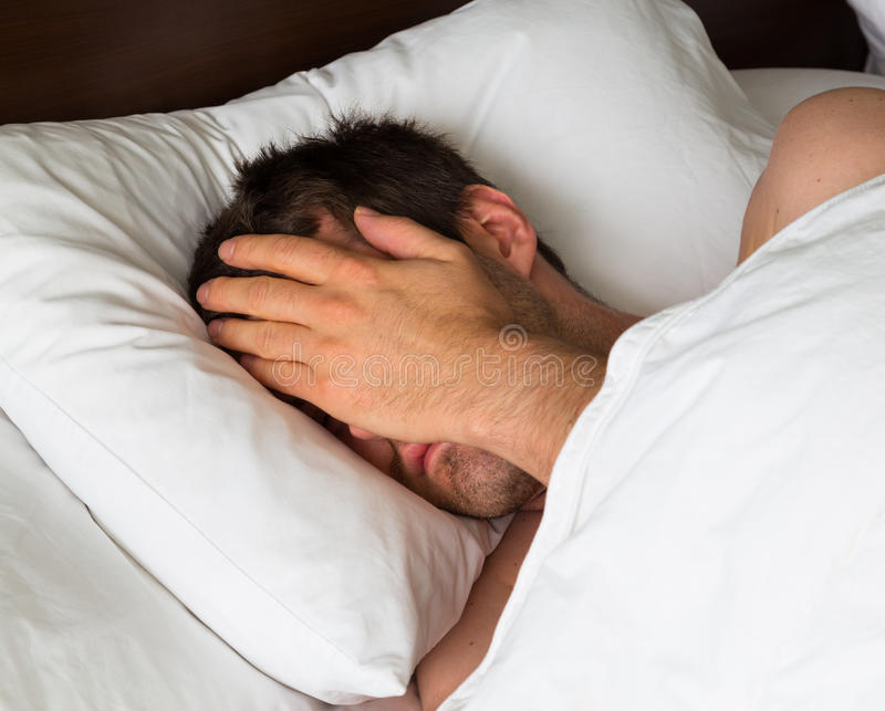 Man Covering Eyes with Hand royalty free stock photos