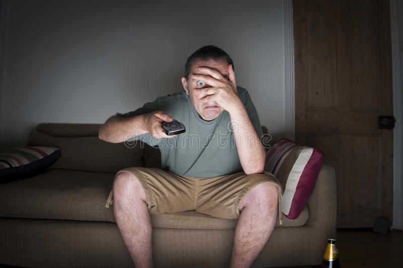 Download Man Covering His Eyes Watching Tv Stock Photo - Image: 32367526