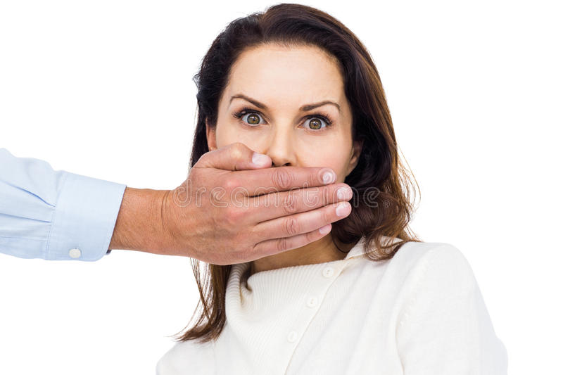 Man covering wifes mouth royalty free stock images