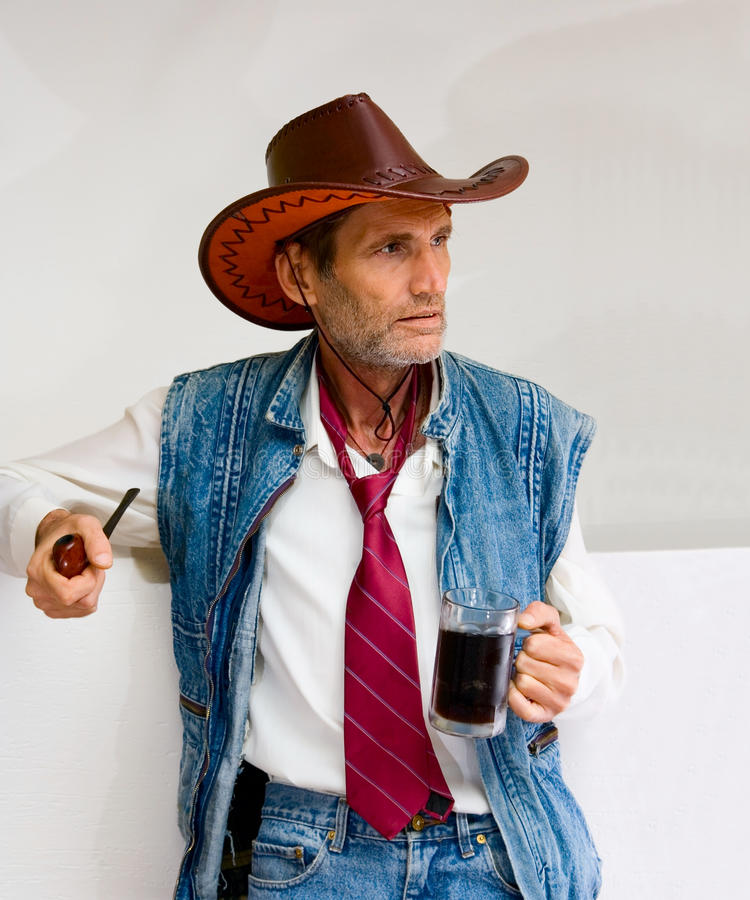 Download Man In Cowboy Hat With Mug And Pipe Stock Image - Image: 12922049