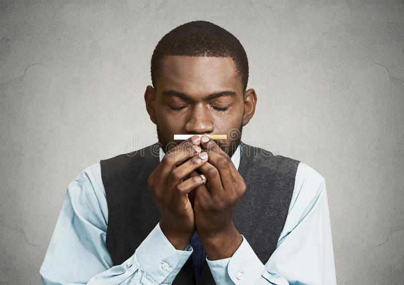 Man craving a cigarette royalty free stock photos