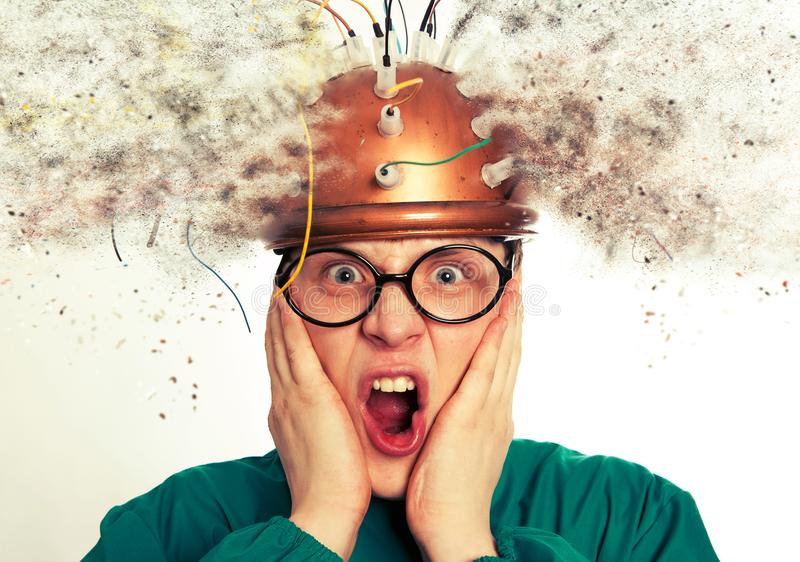 Man crazy inventor wearing a helmet brain research royalty free stock photos