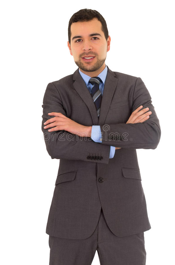Man crossing arms standing in a suit royalty free stock image