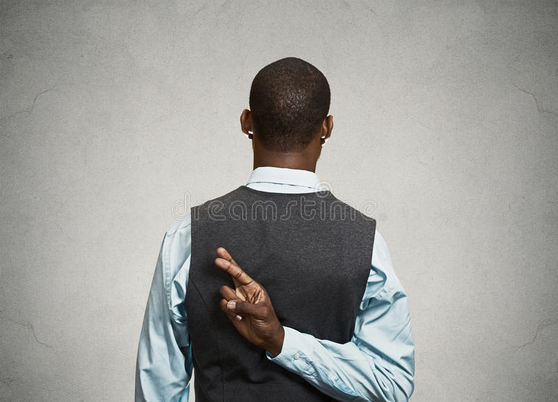 Man crossing fingers behind his back royalty free stock images