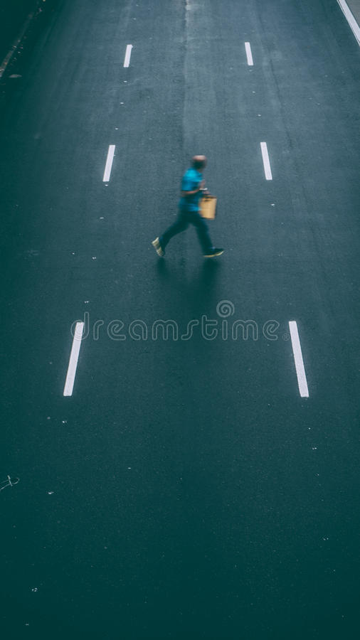 Man Crossing The Street stock images