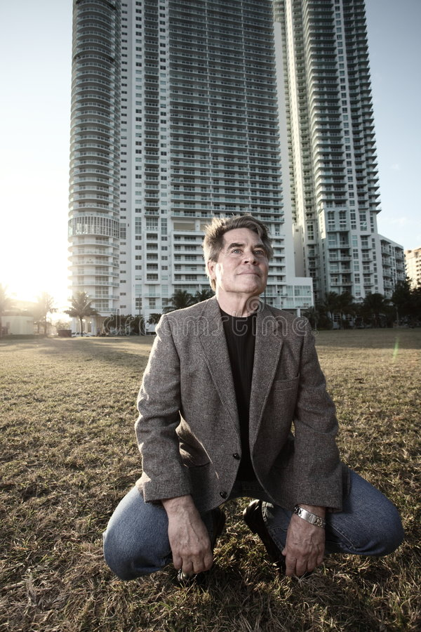 Download Man Crouching And Smiling Stock Images - Image: 7485524