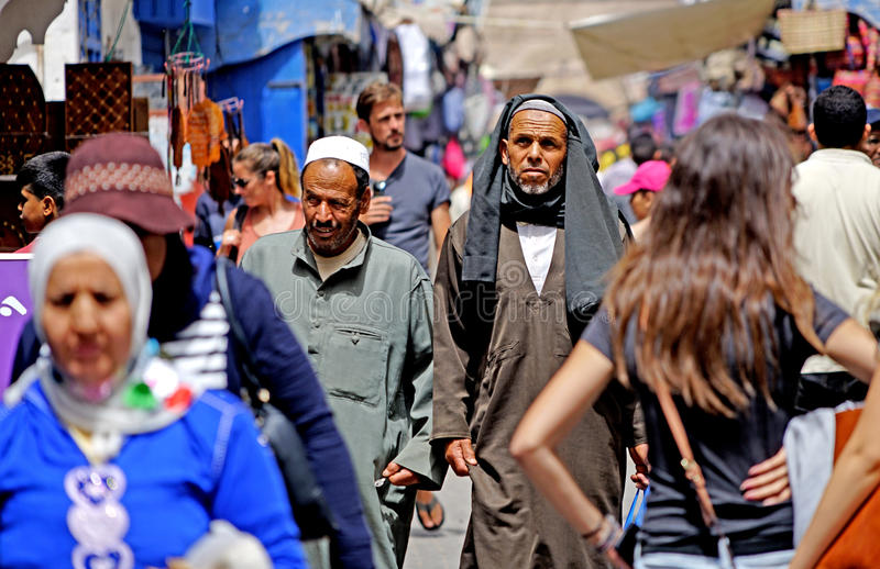 Man among the crowd at the medina Essaouira. Essaouira Morocco An Arab man is walking in the medina Essaouira in Arabic: الصويرة, al-Ṣ royalty free stock images