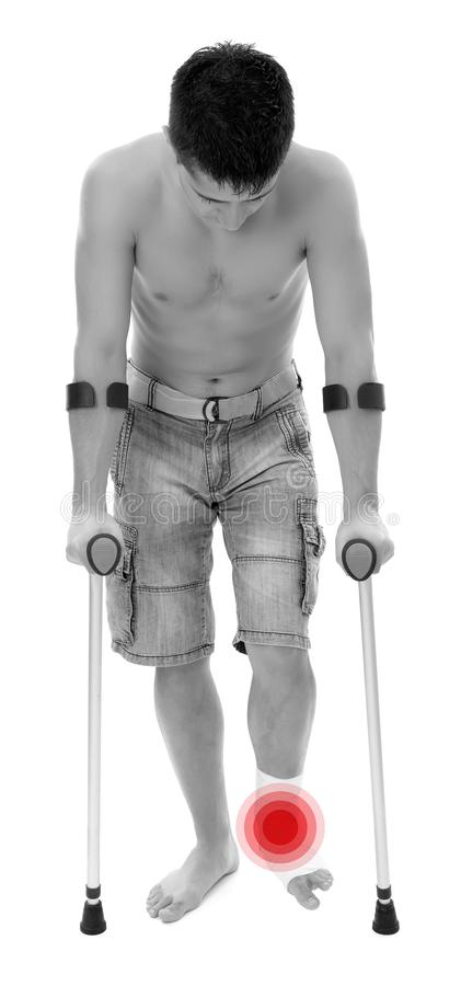 Man with crutches royalty free stock images