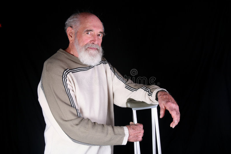 Man with crutches royalty free stock photos