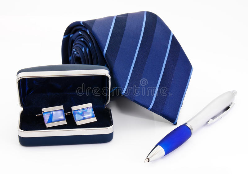 Man cuff links in box pen and tie. On white royalty free stock images