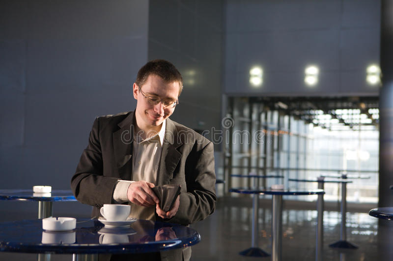 A man with cup at cafe royalty free stock photography