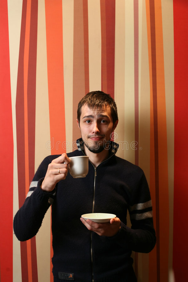 Man with cup of coffee. Cool young man with cup of tea or coffee royalty free stock photo