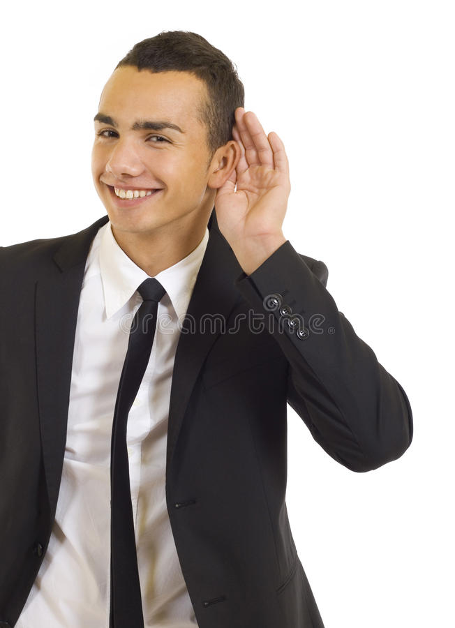 Man cupping hand behind ear royalty free stock photo