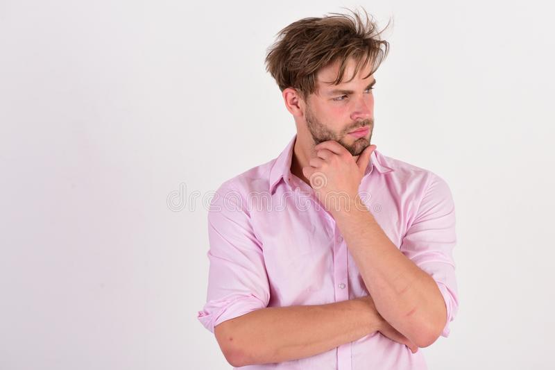 Man with curious and thoughtful face on white background stock photo