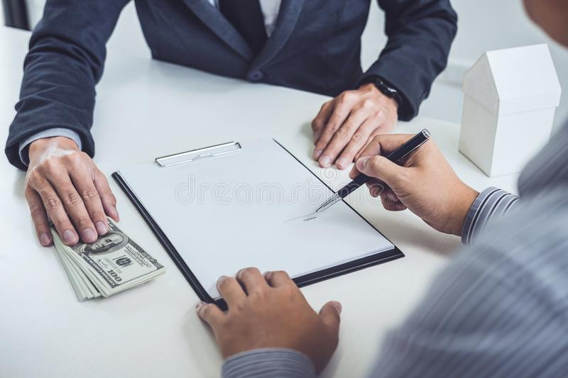 Man customer signing buying home policy document agreement, successful loan contract and salesman receive money after good deal.  stock images
