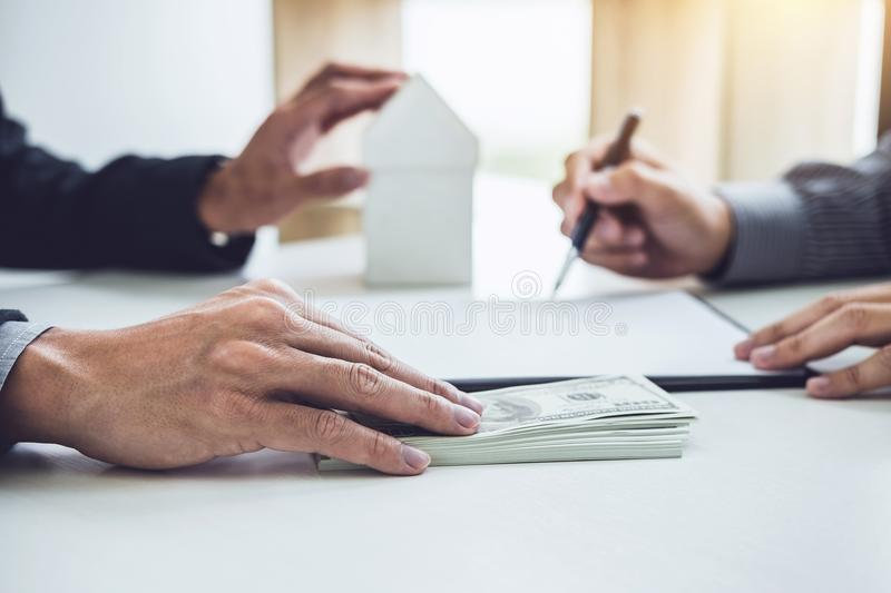 Man customer signing buying home policy document agreement, successful loan contract and salesman receive money after good deal.  stock photography