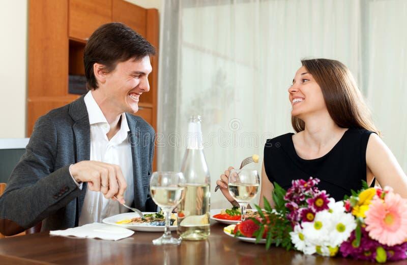 Man and cute woman having romantic dinner stock photo