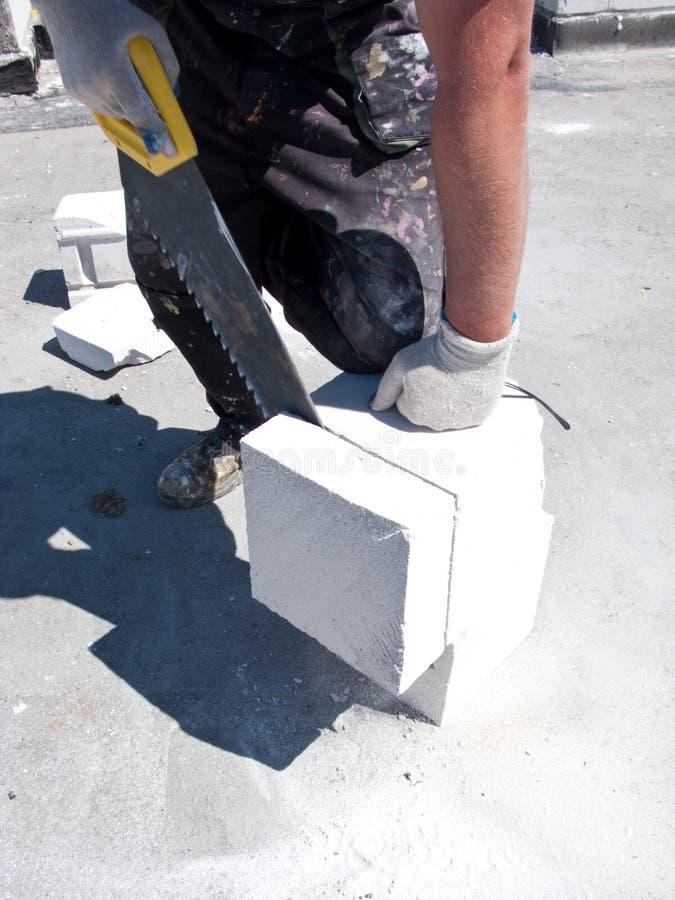 Man cutting concrete block
