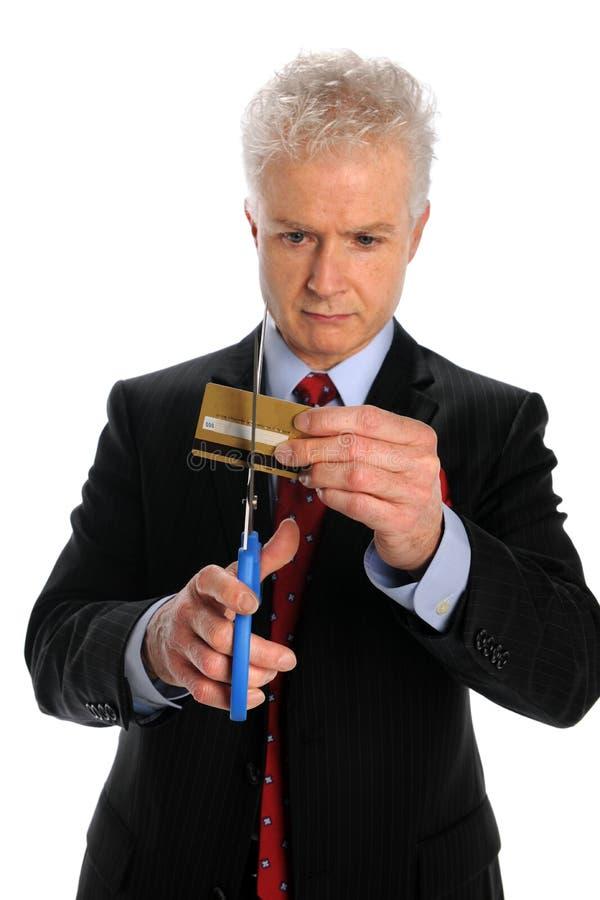 Man Cutting Credit Card stock photography