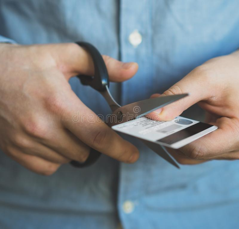 Man cutting credit card. royalty free stock photography