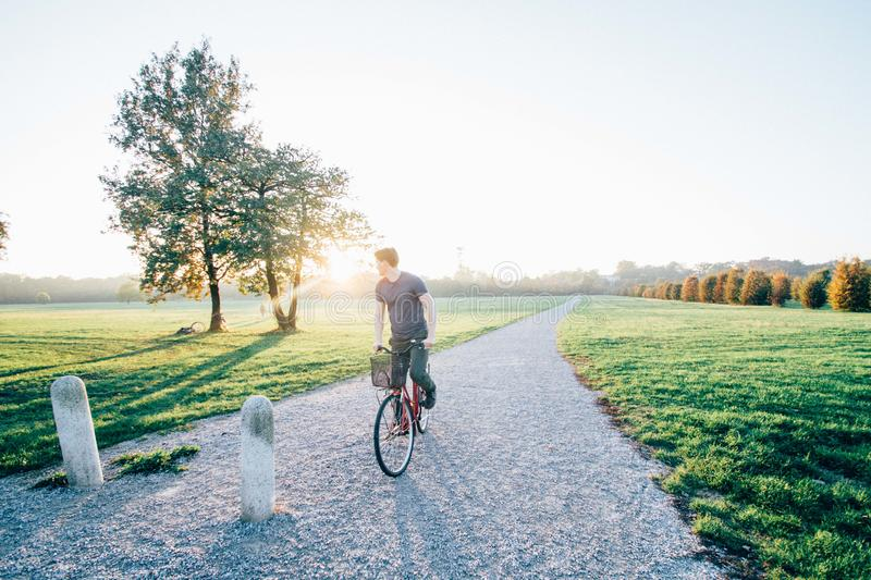 Man cycling in countryside royalty free stock photography