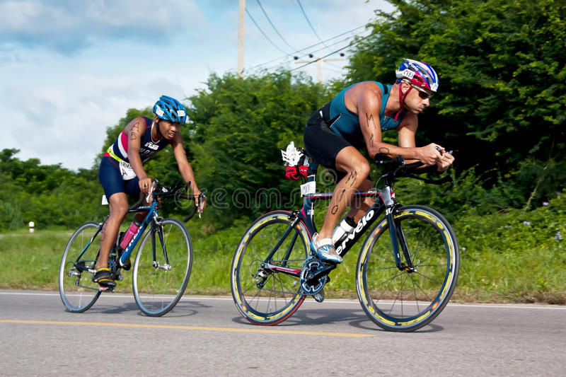 Download Man  cycling in triatlon editorial image. Image of move - 30399060