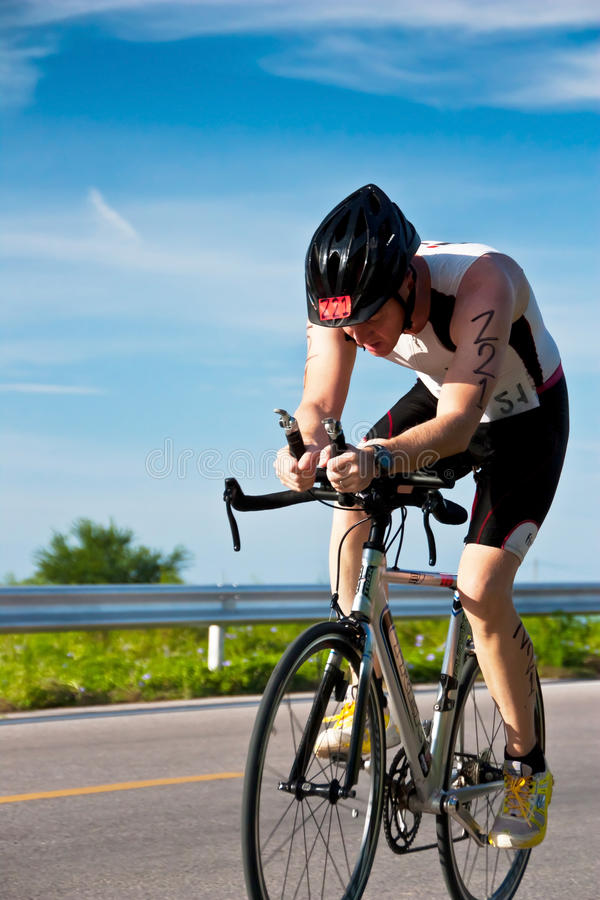 Download Man  cycling in triatlon editorial stock image. Image of bicyclist - 30399089
