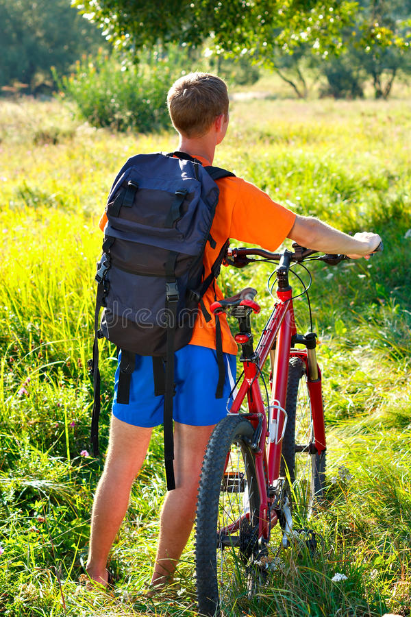 Free Man Cyclist With Bike And Backpack Stock Photo - 21395450