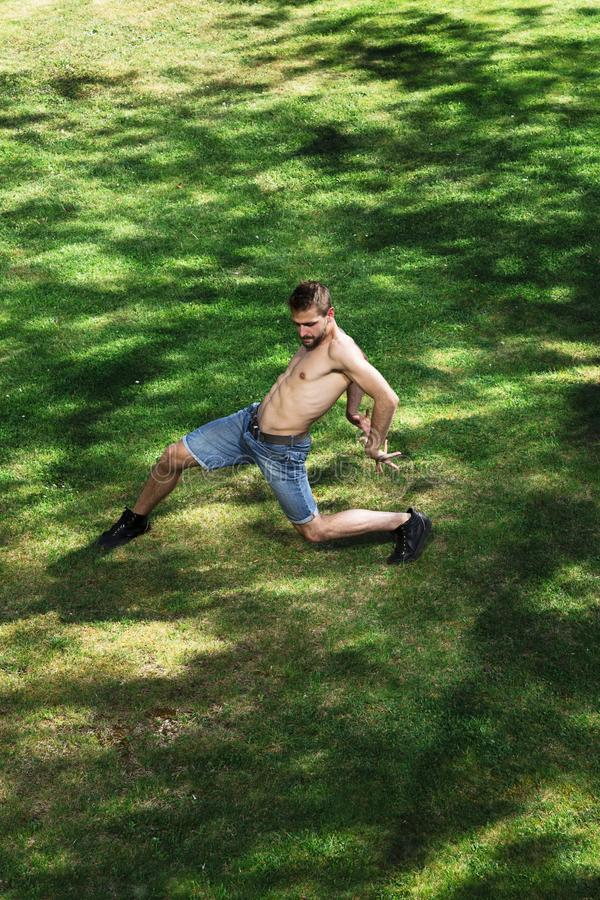 Man dancer of ballet or contemporary dance in park royalty free stock photo