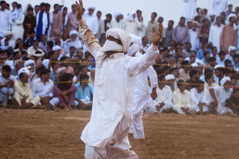 A man dancing in a bull race event. Tradition, culture, sport, sports, life royalty free stock photography