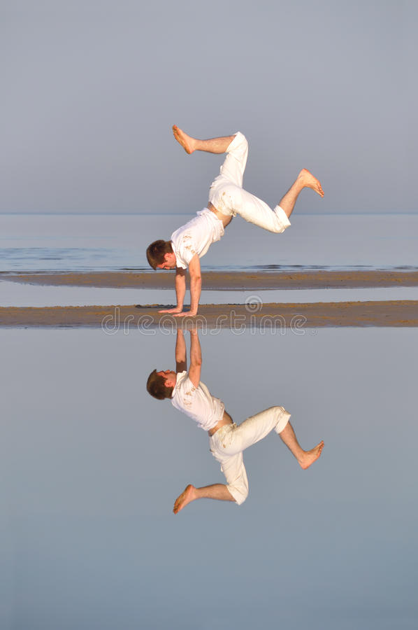 Man Is Dancing Near The Sea Royalty Free Stock Photo