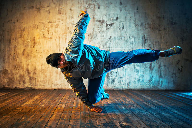 Man dancing on wall background stock images