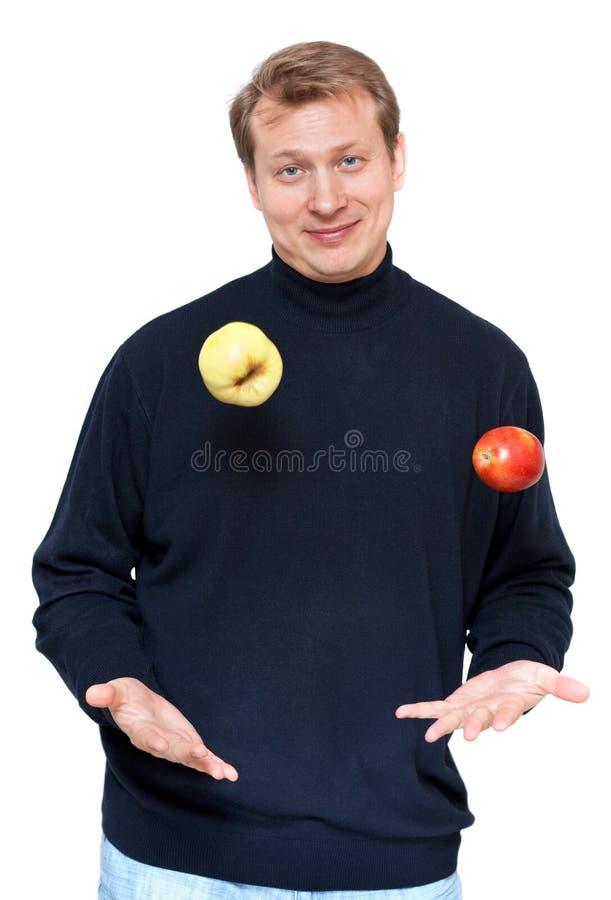Man In Dark Cloth Juggle Apple Stock Photography