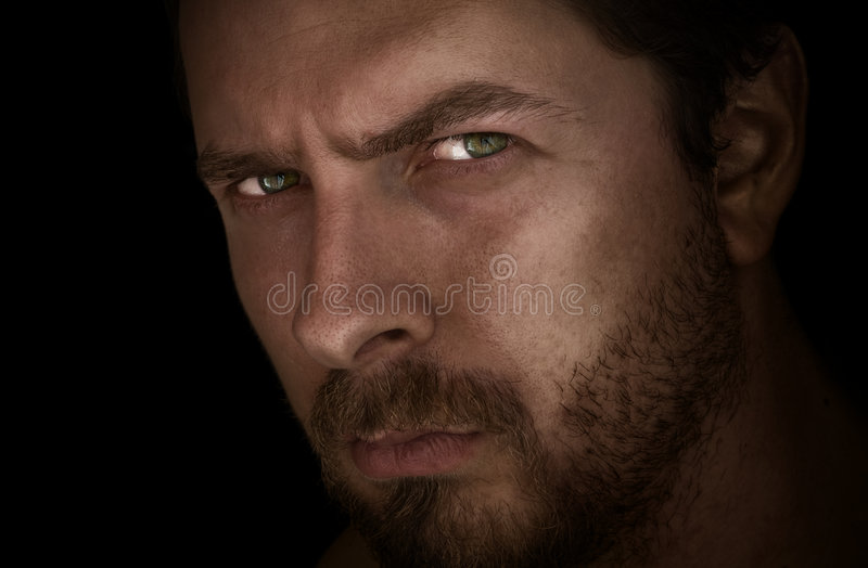 Man In The Dark With Deep Evil Eyes Stock Images