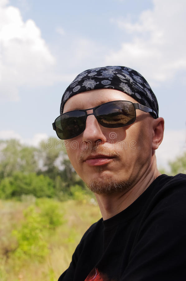 Download Man In Dark Glasses And A Bandana On His Head Stock Photo - Image: 83710302