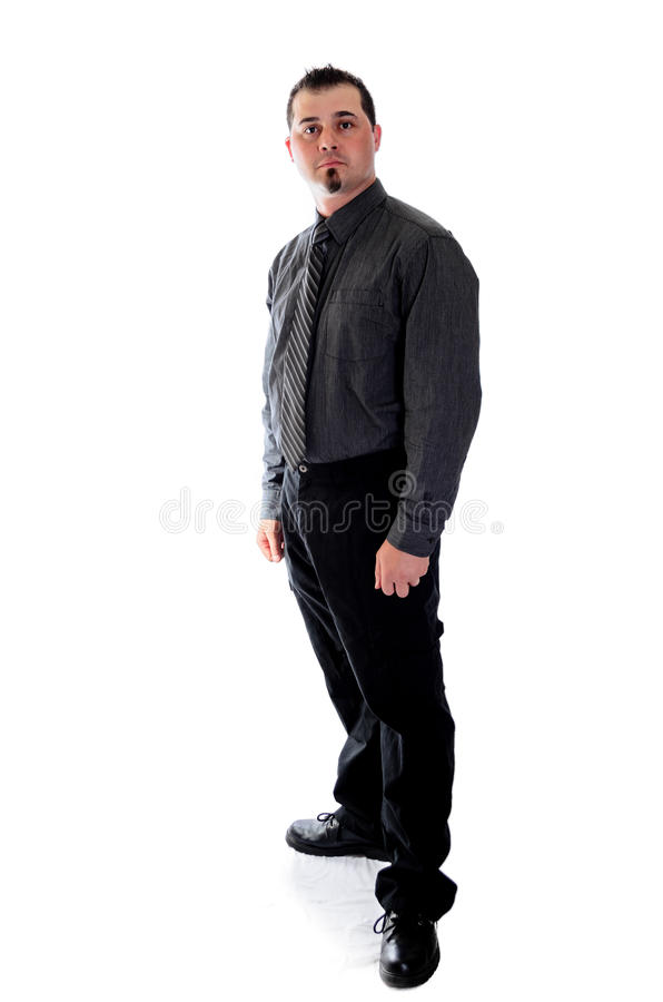Man in dark grey shirt and tie. A Man in dark grey shirt and tie looking at you royalty free stock photo