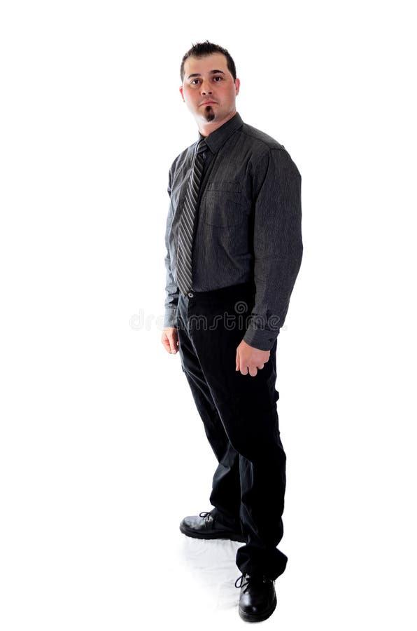 Man in dark grey shirt and tie royalty free stock photo
