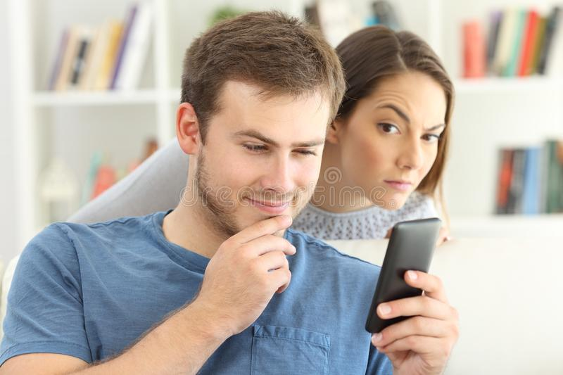 Man dating on line and girlfriend spying royalty free stock images