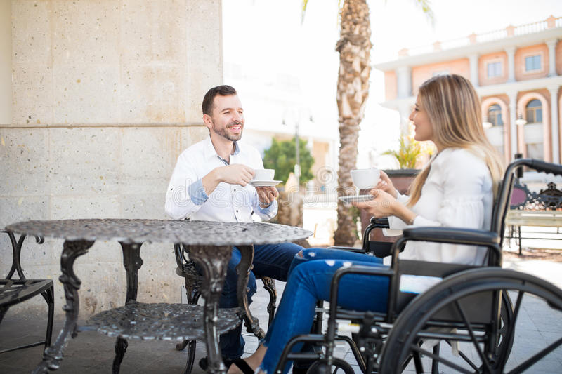 Man dating woman in a wheelchair stock photography