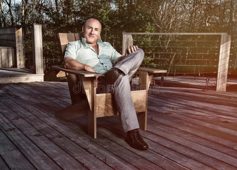Man in deck chair royalty free stock photography