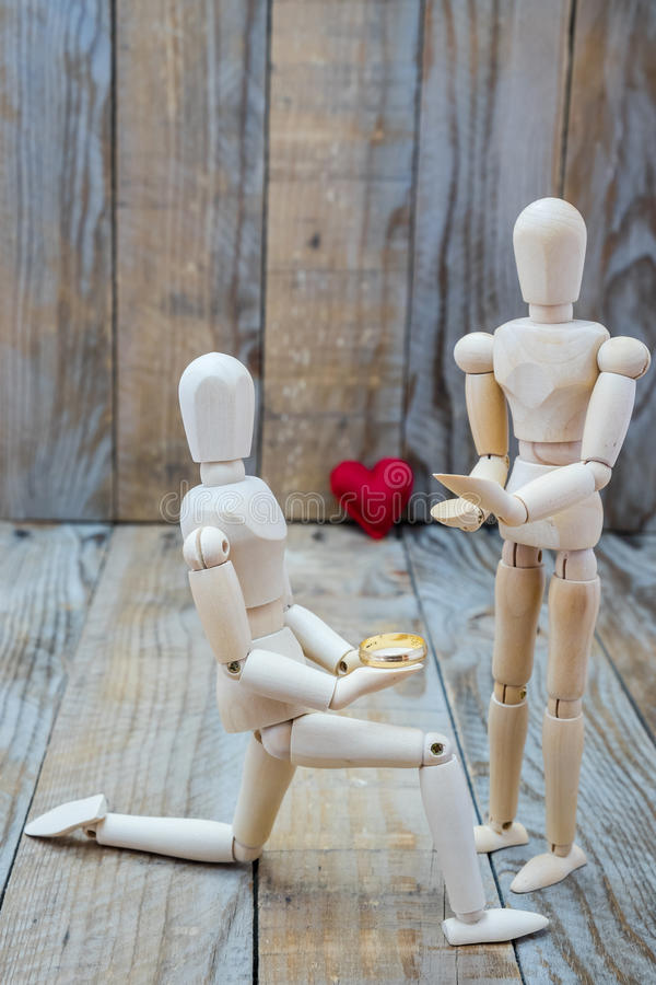 Man declaring his love to a woman. Man asking marriage and declaring his love to a woman Valentine's Day stock photos