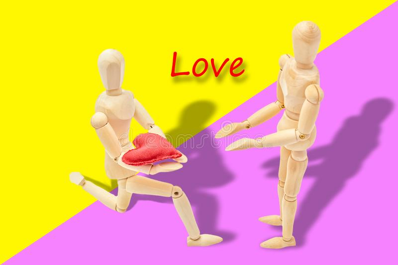 Man declaring his love to a woman. On Valentine`s Day royalty free stock photography