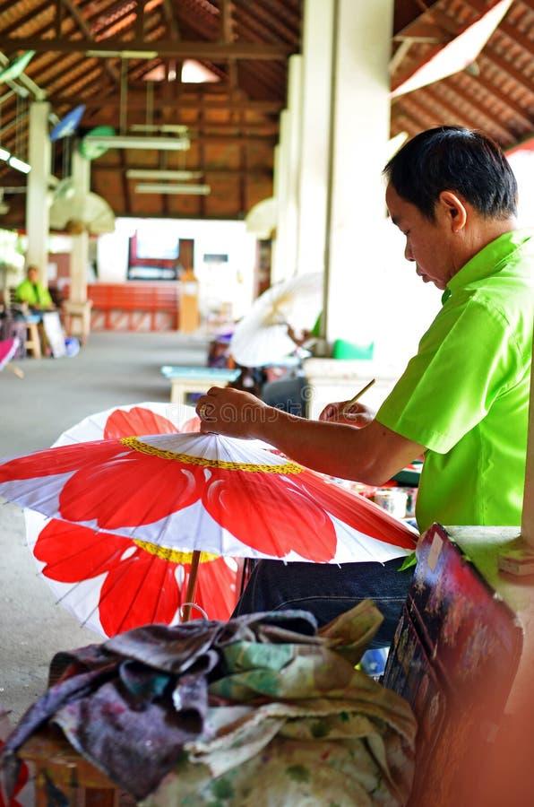Download Man decorates umbrella editorial image. Image of souvenir - 25052275