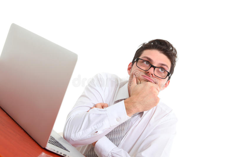 Man deep in thoughts with computer royalty free stock images