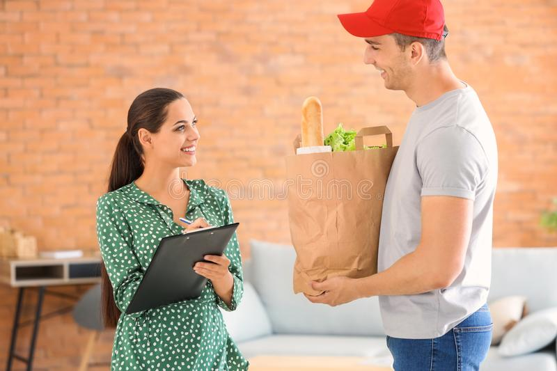 Man delivering food to customer indoors royalty free stock photos